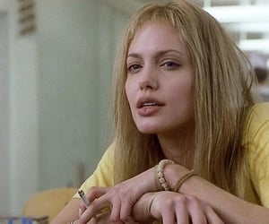 Angelina Jolie, book, and girl interrupted image