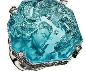 blue, aquamarine, and carved image