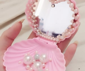 pink, pearls, and mirror image