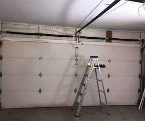 free estimates, call mh garage door inc, and and 24 7 support. image
