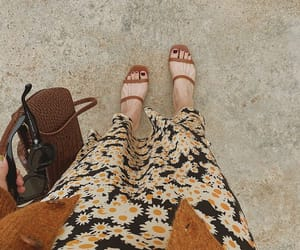 floral skirt, sunglasses, and cardigan image