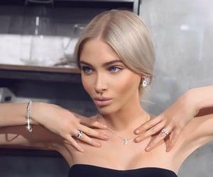 blonde, blue eyes, and bun image