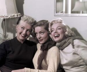Marilyn Monroe, Betty Grable, and Lauren Bacall image