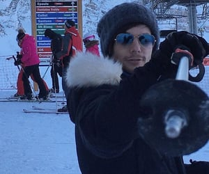 Skiing, one direction, and louis tomlinson image