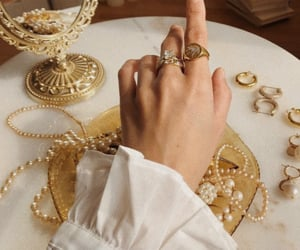 gold, mirror, and rings image