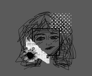black, gray, and newspaper image