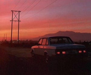 car and sunset image