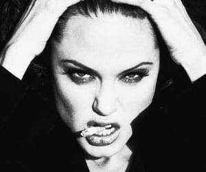 Angelina Jolie, savage, and wild image