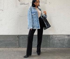 black heels, black pants, and short dark hair image