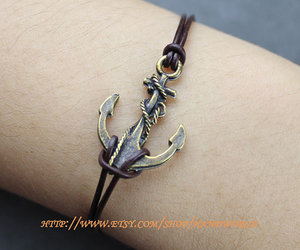 chain, brown leather bracelet, and bronze anchor bracelet image