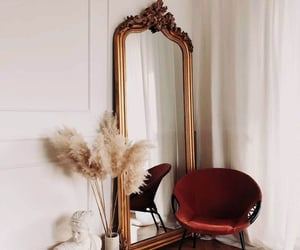 big mirror, chair, and plant image
