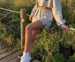mini skirt, crop top, and long sleeve top image