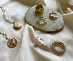 gold ring and medallion necklace image