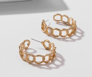 gold hoop earrings and the outlier image