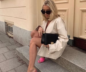 short blonde hair, black chanel bag, and pink heels shoes image