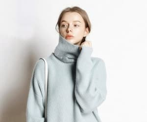sky blue and turtleneck sweater image