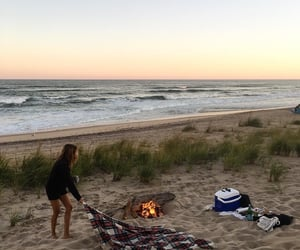 beach, fire, and sea image