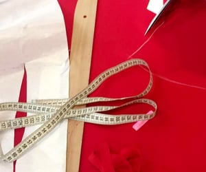 fabric, measuring tape, and red image