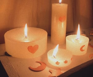 candles, dark, and fire image