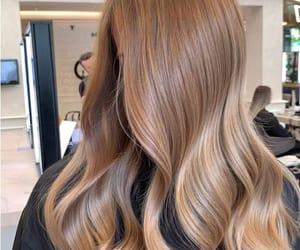 hair extensions, flattering haircut, and medium-length curly lob image
