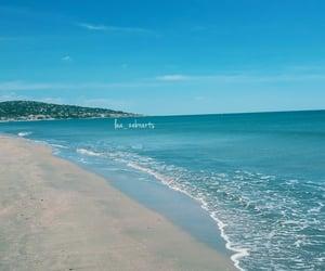 blue sky, sand, and shell image