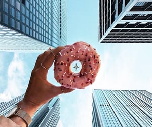 donut, mobile phone, and skyscraper image