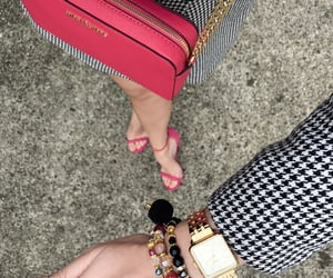 arm candy, hot pink, and Michael Kors image