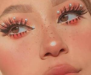 blush, eyeliner, and freckles image