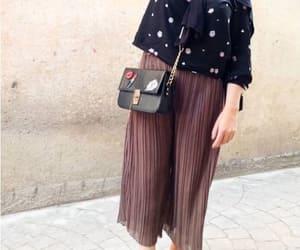 pleated pants image