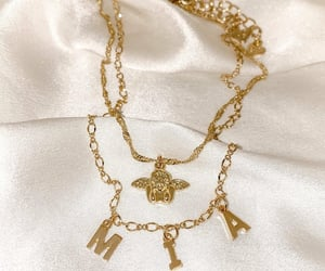 necklace, accessories, and brand image