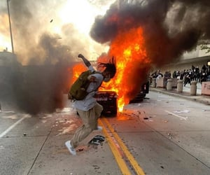 fire, cyber, and protest image