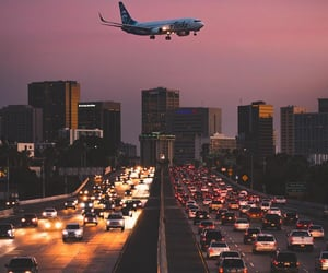 airplane, cars, and city image