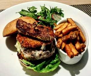 Wagyu beef burger with foies gras, portobello mushroom, fries and salad.