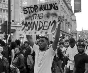 black and white, london, and police brutality image