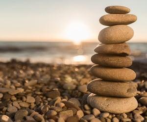 ocean, rocks, and pebbles image