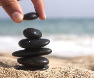 black, ocean, and rocks image