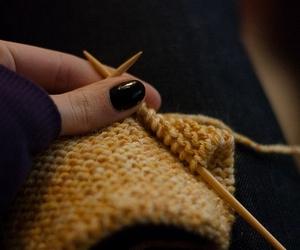 knitting and painted nails image