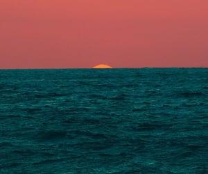sunset, ocean, and sun image