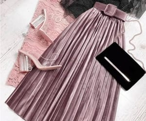 blouse and pleated skirt image