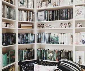 books, bookshelf, and bookworm image