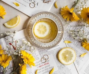 cup of tea, flowers, and lemon image