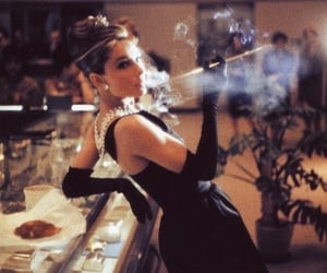 audrey hepburn, black dress, and cigar image