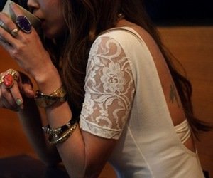 back tattoo, bracelets, and rings image