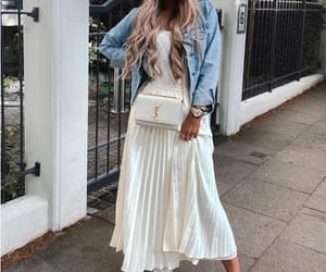 tee and pleated skirt image