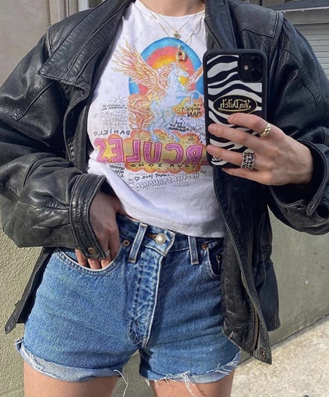 graphic tee, jeans, and leather jacket image