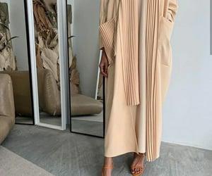 hijab, interior home, and muslim girl image