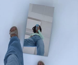 long sleeve top, green crop top, and mirror selfie image