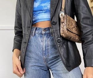 black leather jacket, denim jeans, and tie dye shirt image