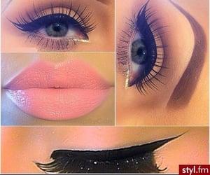 cat eye, eyelashes, and pink lipstick image