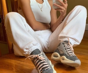white tank top, sportswear, and white outfit image